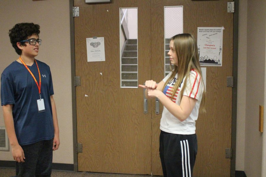 Freshmen Matthew Santos-Barrera and Chloe Oswall sign about their Monday through Friday schedule on Monday, Nov. 25.