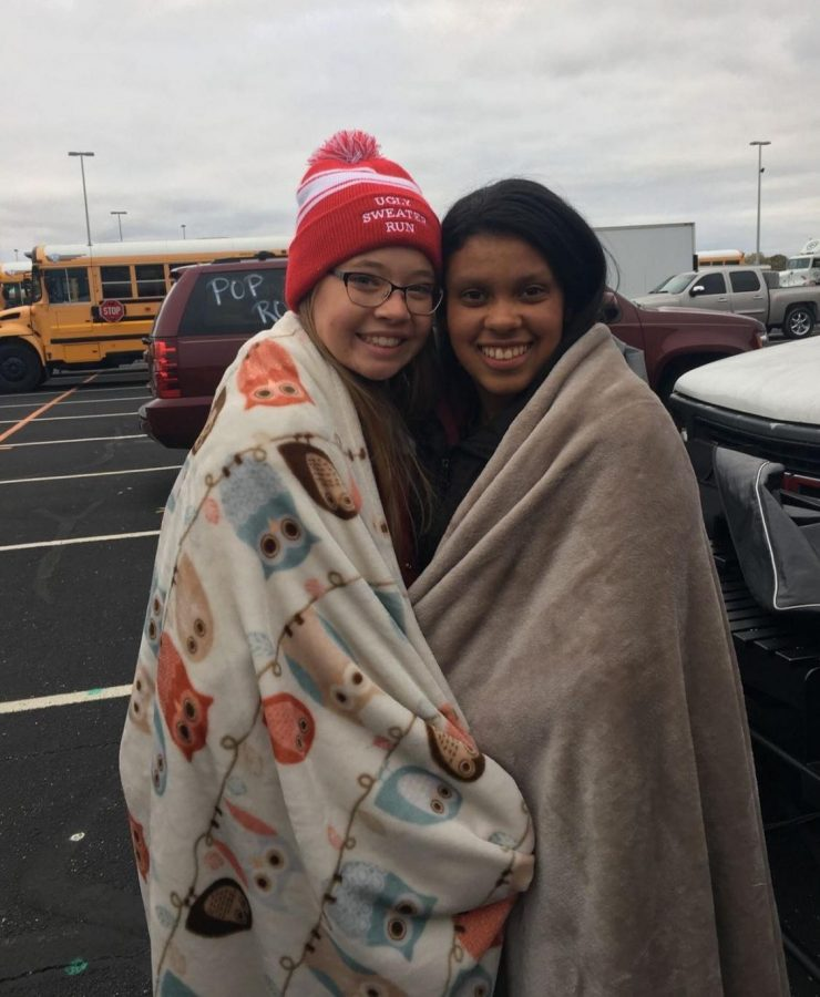 Junior Rebecca Ekema and sophomore Porschia Kemery pose for a picture while trying to stay warm on Saturday, Nov. 2 at the Marching Band Semistate competition.