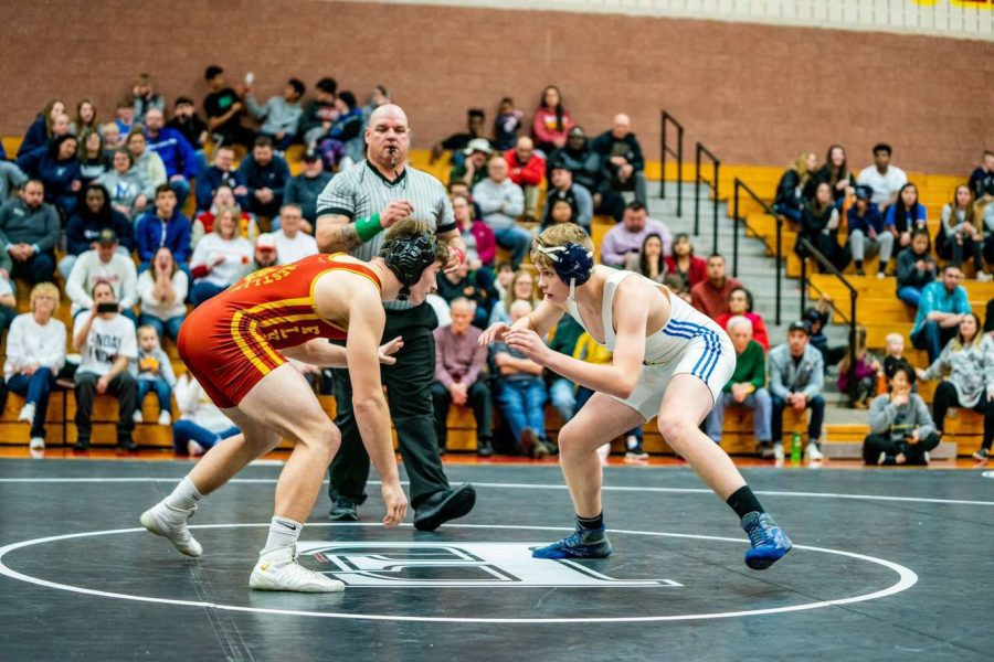 Junior Clayton Lundy begins his match in his 170lb weight class just before dominating the match on Tuesday Dec. 17. Lundy has been a starter for the wrestling team since his freshman year.