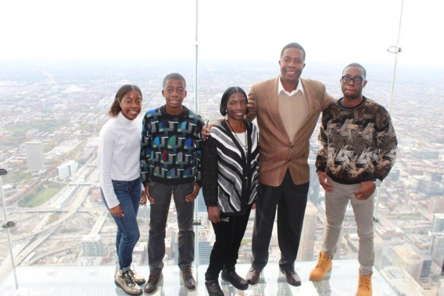 Precious with her two brothers and parents in Chicago, Illinois on Oct. 25.