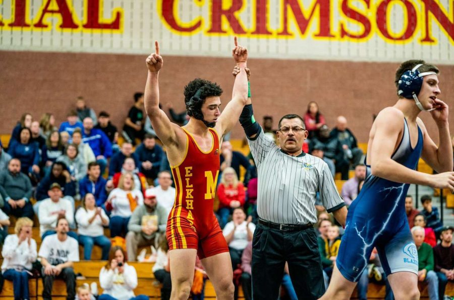 Senior Kamden Goering celebrates his victory in the 160 lb weight class on Tuesday, Dec. 17. Goering went all the way to the Semi-State tournament during the 2018-2019 season.