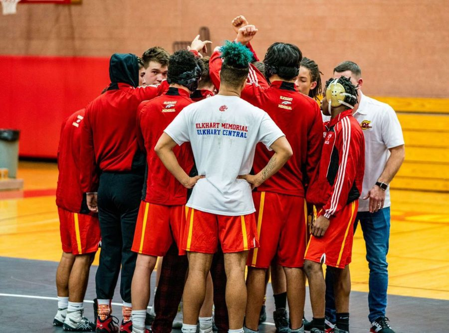The Elkhart Memorial Crimson Chargers wrestling team huddles together before the start of their meet on Tuesday, Dec. 17. where the Chargers would go on to face the Elkhart Central Blazers soon after.