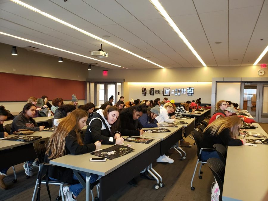 Juniors and seniors from Memorial High School answer a questionnaire during their IUPUI college visit on Mon. Dec. 2.