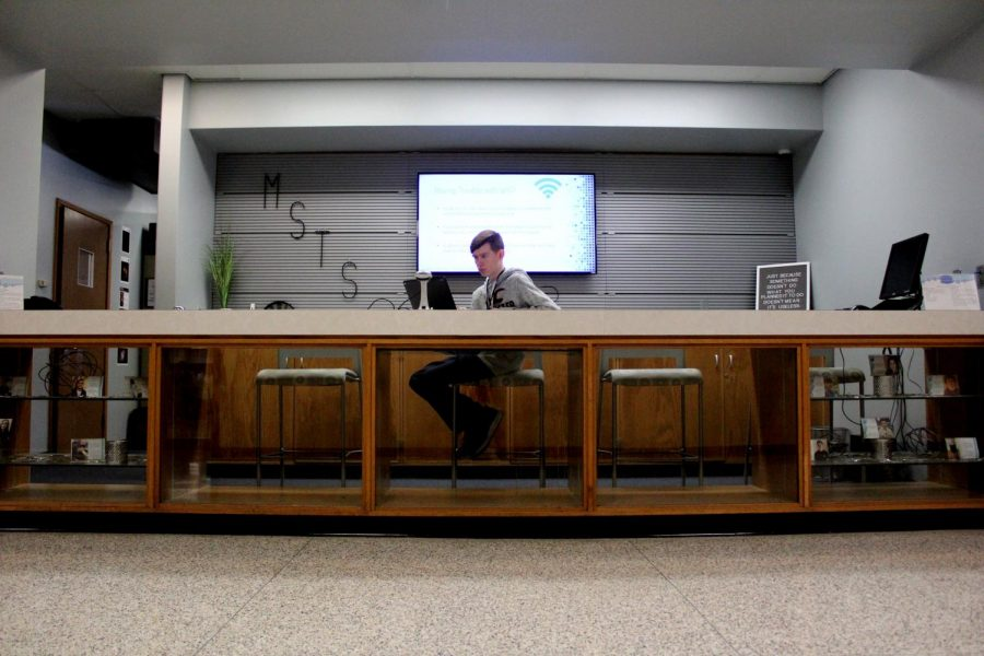 Senior Noah Hardy works as a student-intern at the Memorial Tech Service Desk on Thursday, Dec. 5.