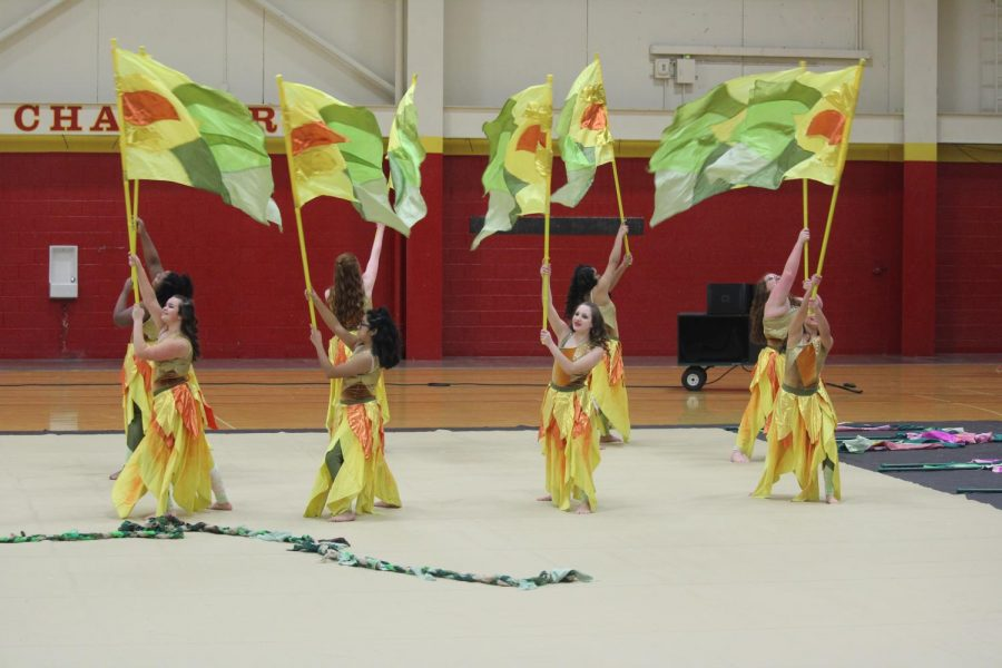 Winter guard members perform at the Memorial home competition in the Fieldhouse during the 2019 season.