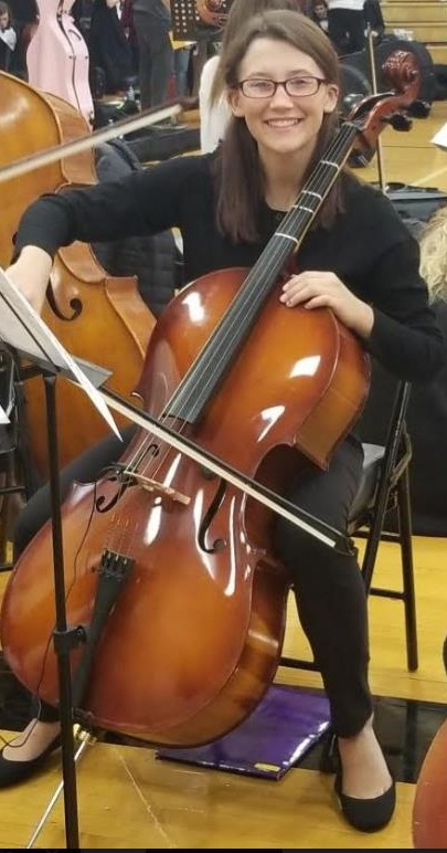 Kimberly Jarrell with her cello while getting set up for an orchestra concert.