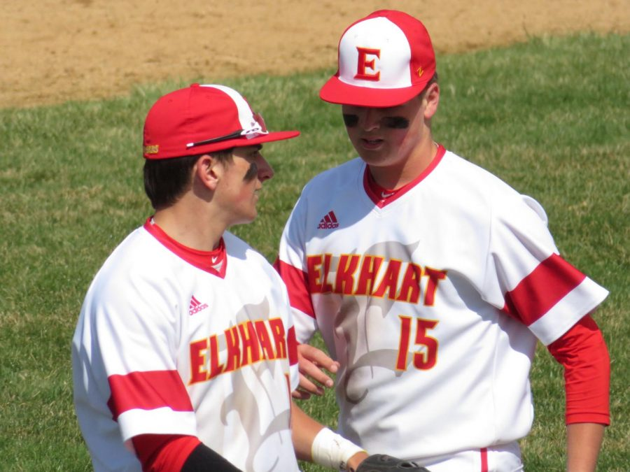 Juniors, Dylan Rost and Bryce Blondell communicating at a baseball game for Elkhart Memorial. Rost plays shortstop and Blondell plays centerfield, they make many memories with each other on and off the field.