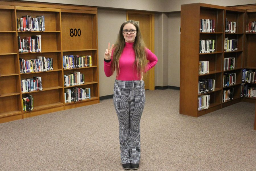 Junior Anastasia deFerbrache takes time during class to pose for a picture on Thursday, Jan. 23 for throwback day.