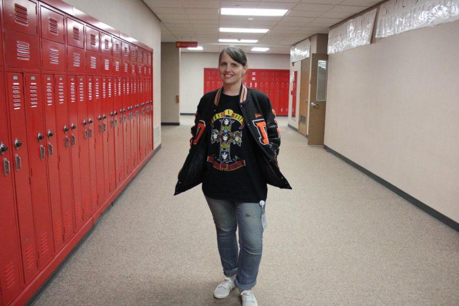 Math teacher Julie Tyrakowski poses with her letterman jacket on Thursday, Jan. 23 for throwback day.