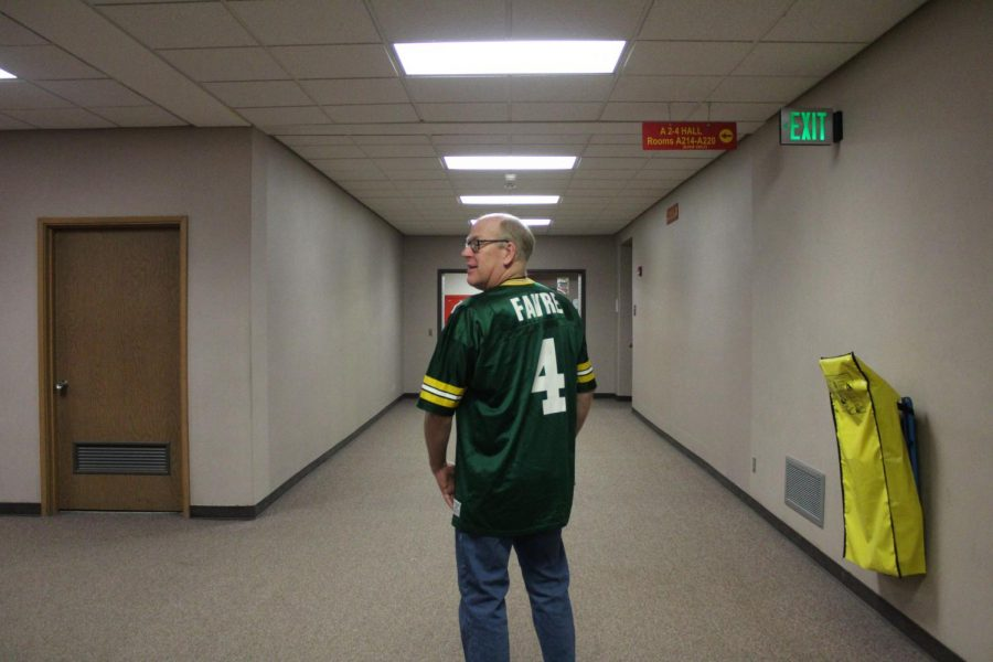 Science teacher Edward Hibshman poses with his Brett Favre jersey, a retired quarterback for the Green Bay Packers, on Thursday, Jan. 23 for throwback day.