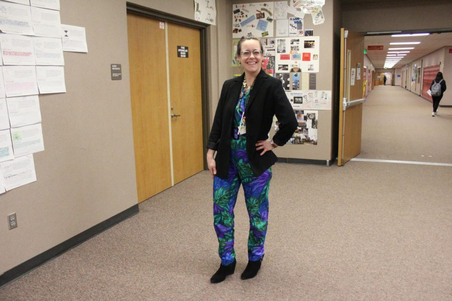 English teacher Megan Lewis poses in her jumpsuit for throwback day on Thursday, Jan. 23.