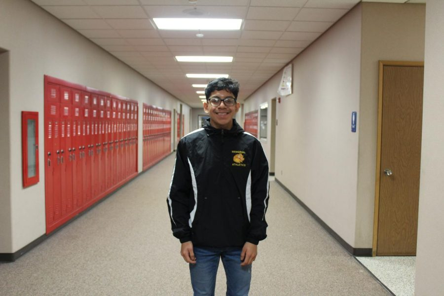 Junior Luis Cruz takes time out of class to take a photo on  Friday, Jan, 24, for Charger pride day.