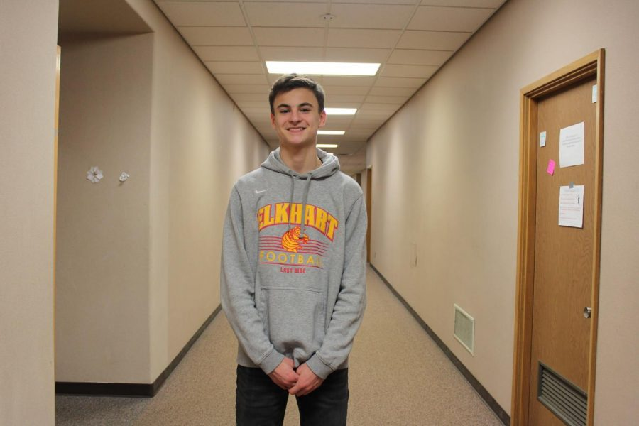 Sophomore Michael Granzotto takes time out of class to pose for a picture on Friday, Jan. 24 for Charger pride day.
