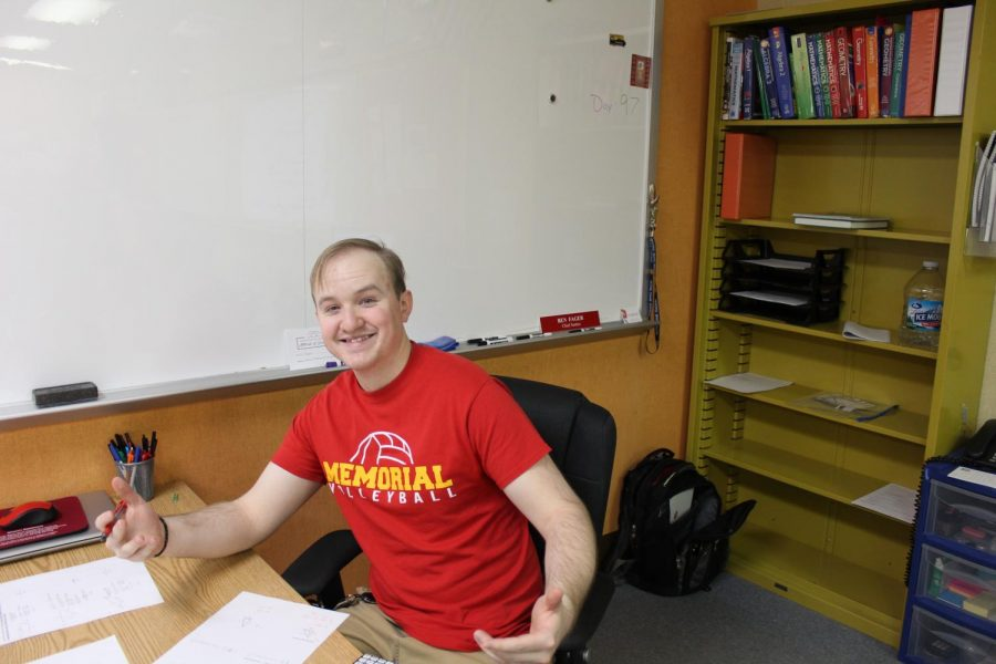 Math Teacher Benjamin Fager takes time during class to pose for a picture on Friday, Jan 24, for Charger pride day.