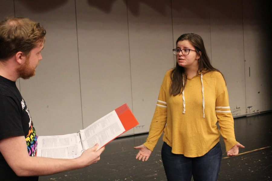 Senior Patsi Ward and assistant director Matt Manley rehearse for the musical