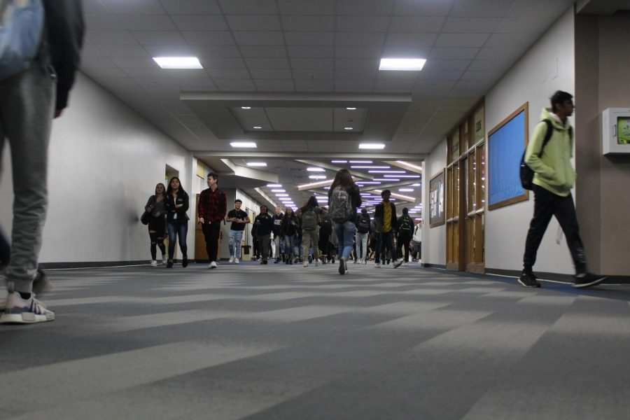 Students walk through the Student Center at Elkhart Memorial during a passing period on Wednesday, Jan. 29.