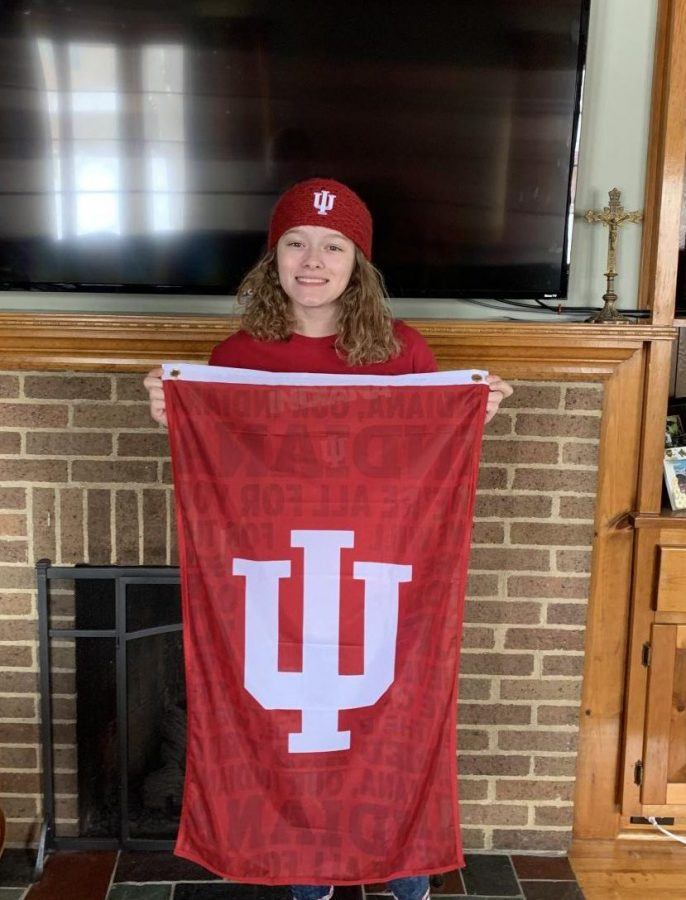 Senior, Laila Nagy, hold up the Indiana University flag she received in her acceptance package. Nagy will attend Indiana University of Bloomington in the fall to study environmental management.
