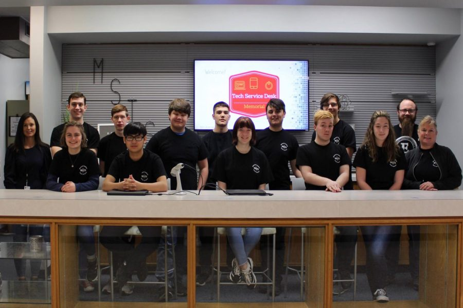 (Top row, left to right: Senior Benjamin Rutledge, Senior Noah Hardy, Senior Alexander Thome, Senior Brayden Hines, Junior Andy Holloman, Sophomore Nathan Taylor, and Supervisor Cory Metcalfe. Bottom row, left to right: Service Desk Coordinator Tiffany Faigh, Senior Abigail Gratzol, Senior Sean Khomphengchan, Sophomore Gracee Brewer, Senior Phillip Meadows, Sophomore Jordan Walls, and MSTS Teacher Heidi Krusenklaus)