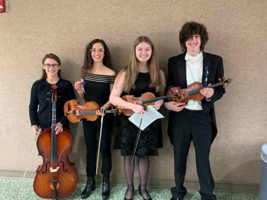 Kimberly Jarrell, Mariana Villasenor, Annie Jacobo, and Tyler Rouch pose for a photo at Elkhart Central High School for their ISSMA District concert, on Saturday, Feb. 1.