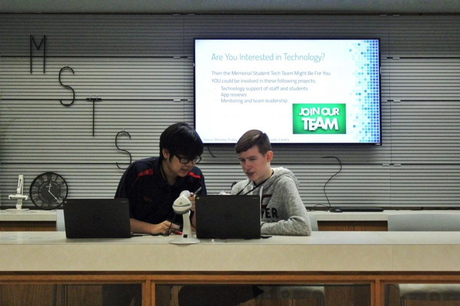 Seniors Sean Khomphengchan and Noah Hardy work as student-interns at the Memorial Tech Service Desk on Wednesday, Dec. 5.