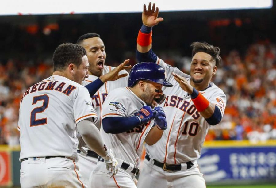 The Houston Astros celebrate Altuve's walk off homerun against the New York Yankees to send them to the world series.