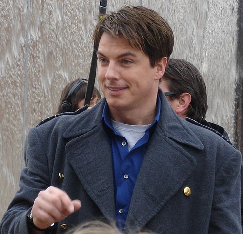 John Barrowman reprised his role as Captain Jack Harkness in season 12. https://creativecommons.org/licenses/by-sa/2.0 /No modifications made.