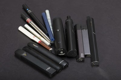 Image of different styles and types of E-cigarettes and juuls. No modifications made https://creativecommons.org/licenses/by/2.0/