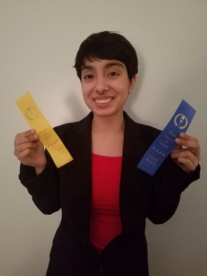 Sophomore Mercedes Moore  celebrates a win at her first Speech and Debate competition of the season at Concord High School on Monday, Nov. 23, 2019.