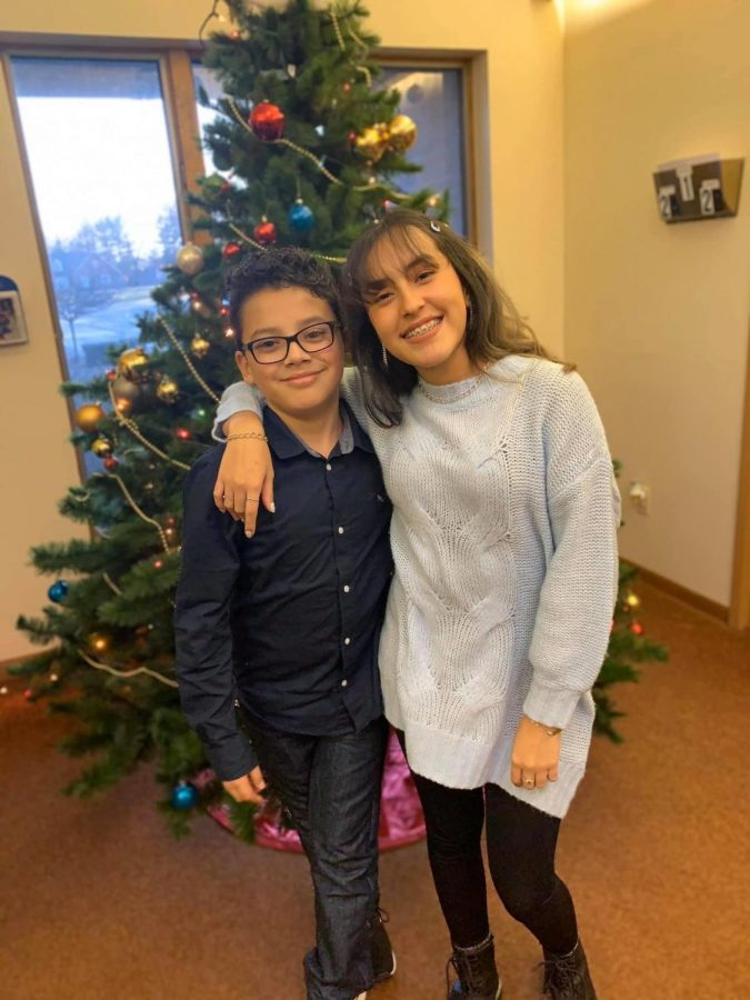 Junior Miri Olivares (right) poses alongside her brother, Isaac Jefté Olivares on Christmas day.