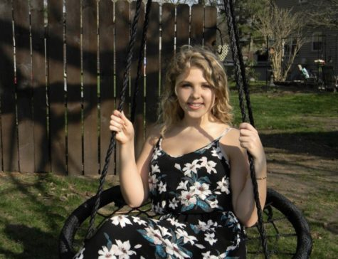 Maddy poses on a swing for a photo taken on April 19. Her hard of hearing started at birth, and since then she has had fourteen surgeries. She shared her inspiring story with GENESIS.