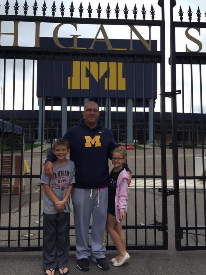 Jeff Miller with his children, Cade and Camryn Tyrakowski, visit the University of Michigan often for football games. Despite their busy school schedule, spending time as a family is a priority.