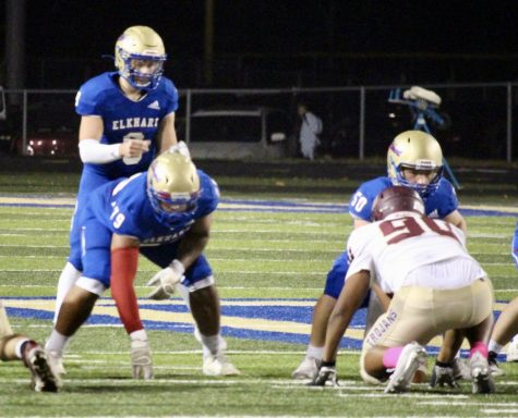 Cameron Wiltfong, #9, sets up to receive the snap on one of the Lions